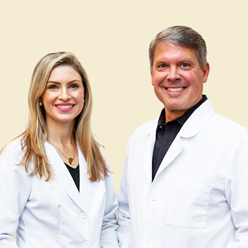 Two Orthodontists smiling in Cornelius NC
